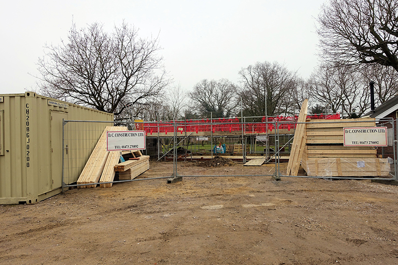 Timber frame and roof trusses arrive on site.