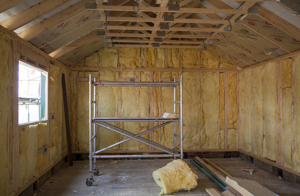 Insulation in place and the shape of the ceiling is revealed.